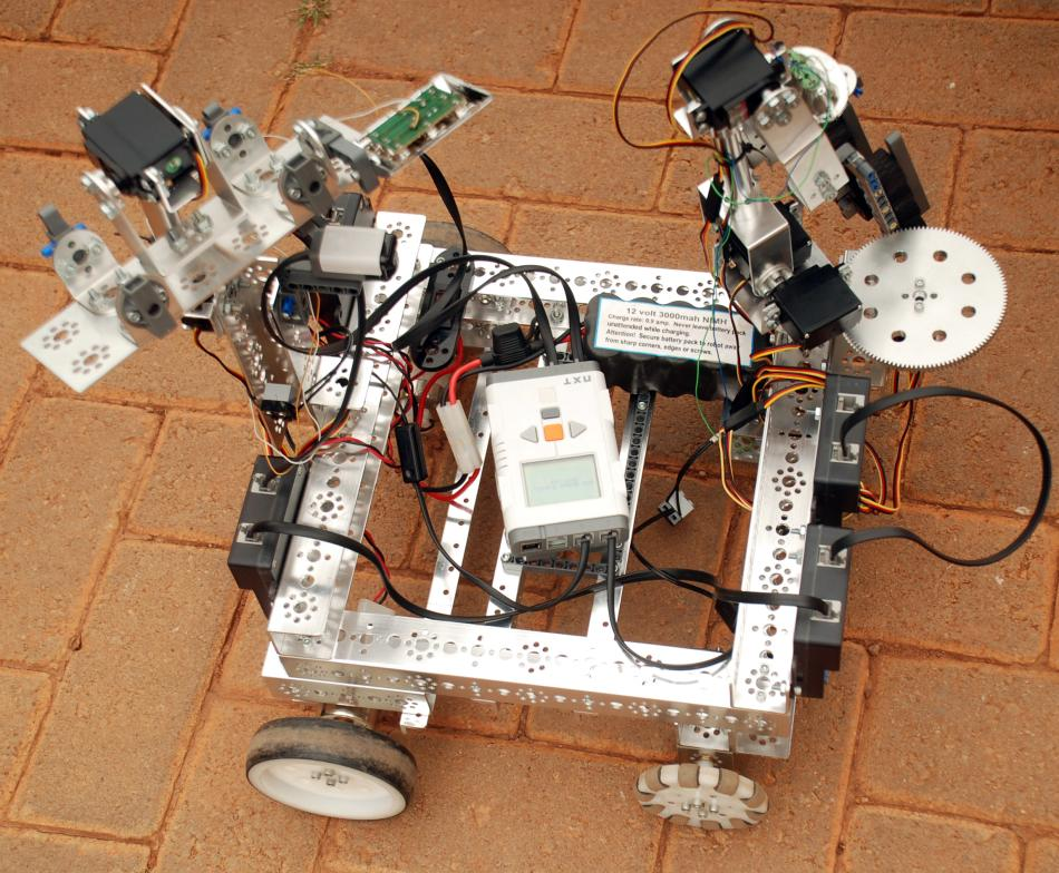 Robot that can detect and disarm explosive materials designed by S6 students at Makerere University