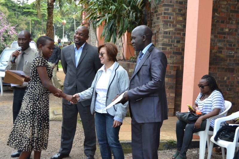 Participant-recieves-certificate-from-Hital-Muraj-m-coorporate-affars-manager-East-and-Central-southern-Africa-CISCO-as-Abraham-Temu-L-Managing-director-KiBO-looks-on.-R-Mayor-of-Entebbe-Muncipality