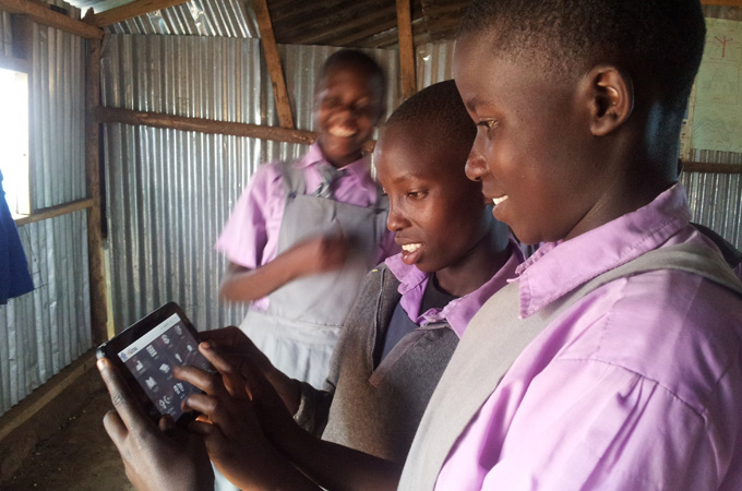 students_holding_tablet