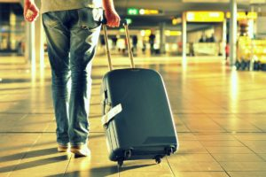 man walking suitcase