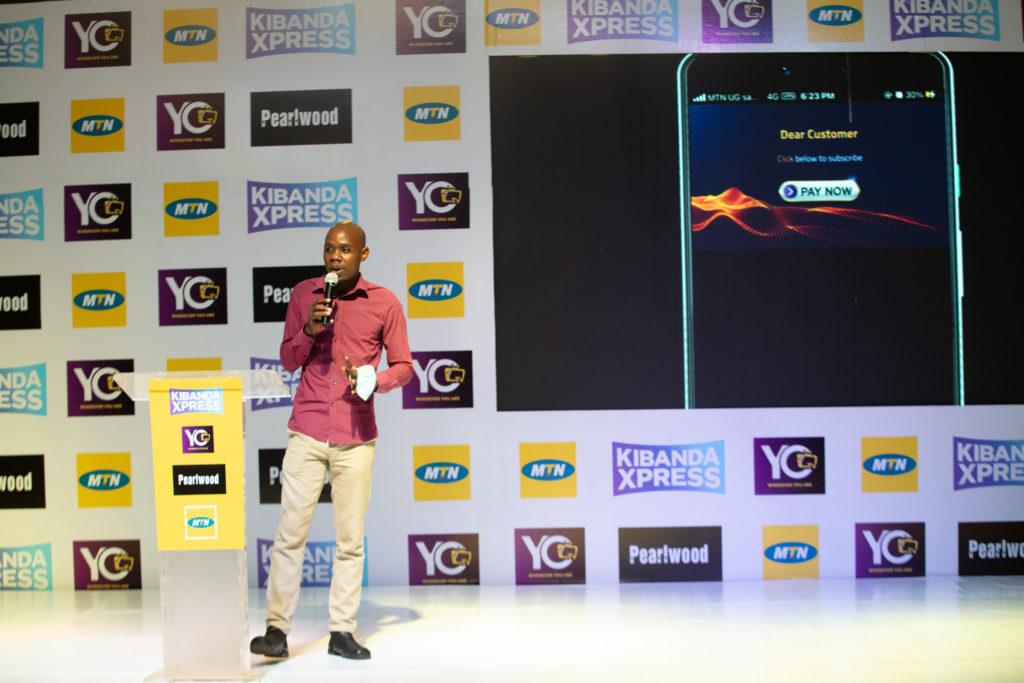 MTN's Onyait Odeke took the audience through the Kibanda Xpress user journey