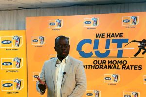 Stephen Mutana while addressing the press at the MoMo withdrawal price cut press conference (1)